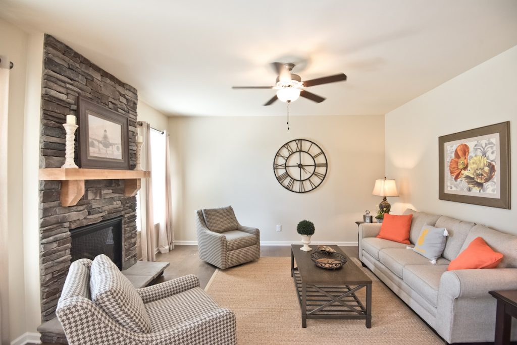 Cozy Family Room with Stone Fireplace - Decorated model home