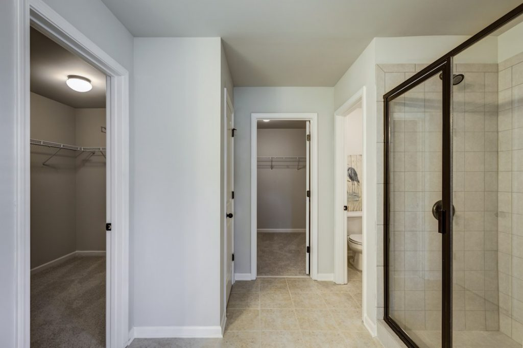 Master bath with his and hers closets at Cowan Ridge
