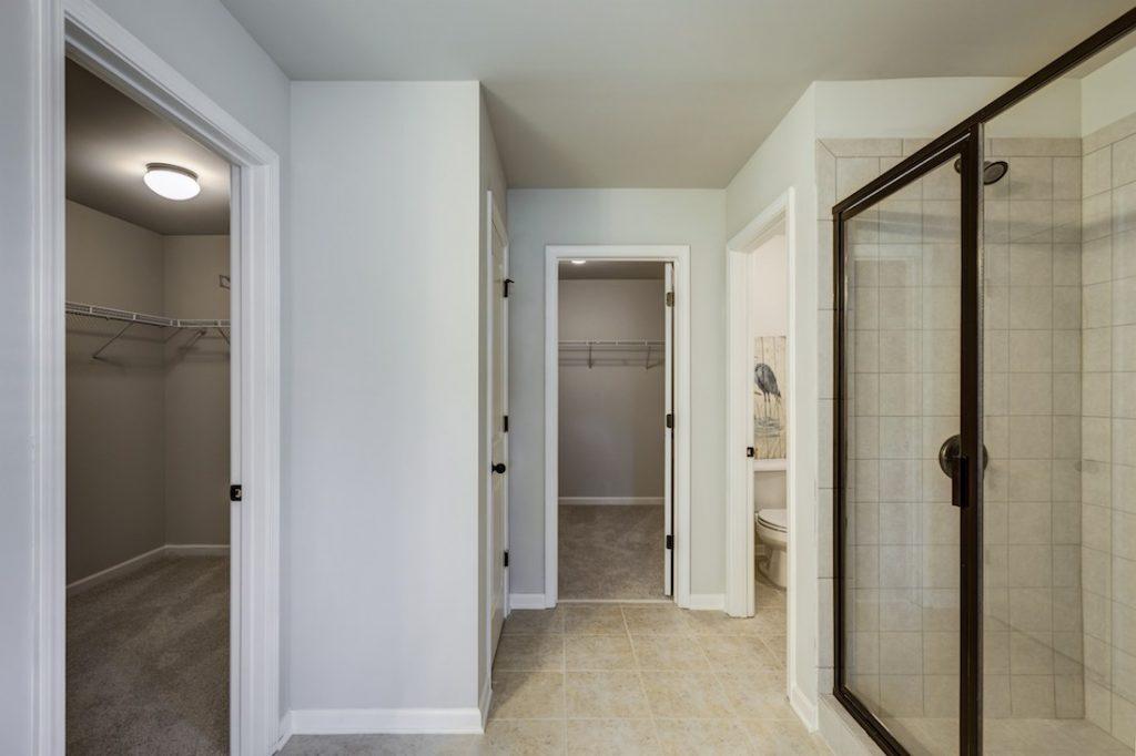 Master bath with his and hers closets at Cowan Ridge