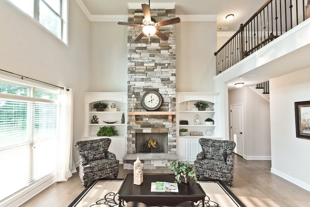 Classic built-in bookshelves on either side of a fireplace add a charming since of style and functionality in your living room.