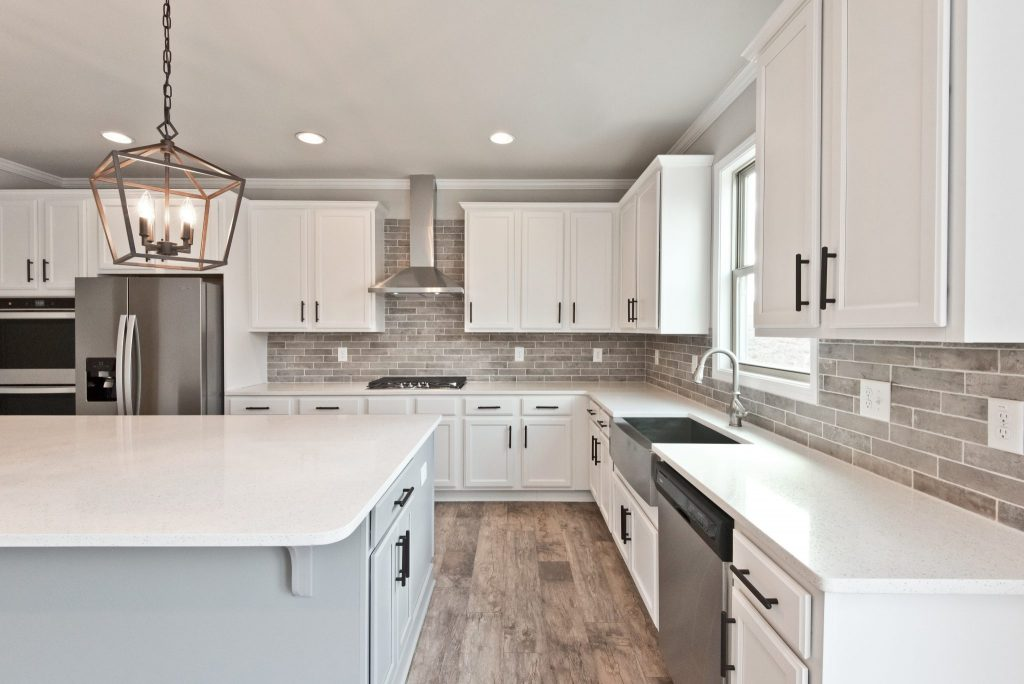 Attractive open concept gourmet kitchen in our Heritage series