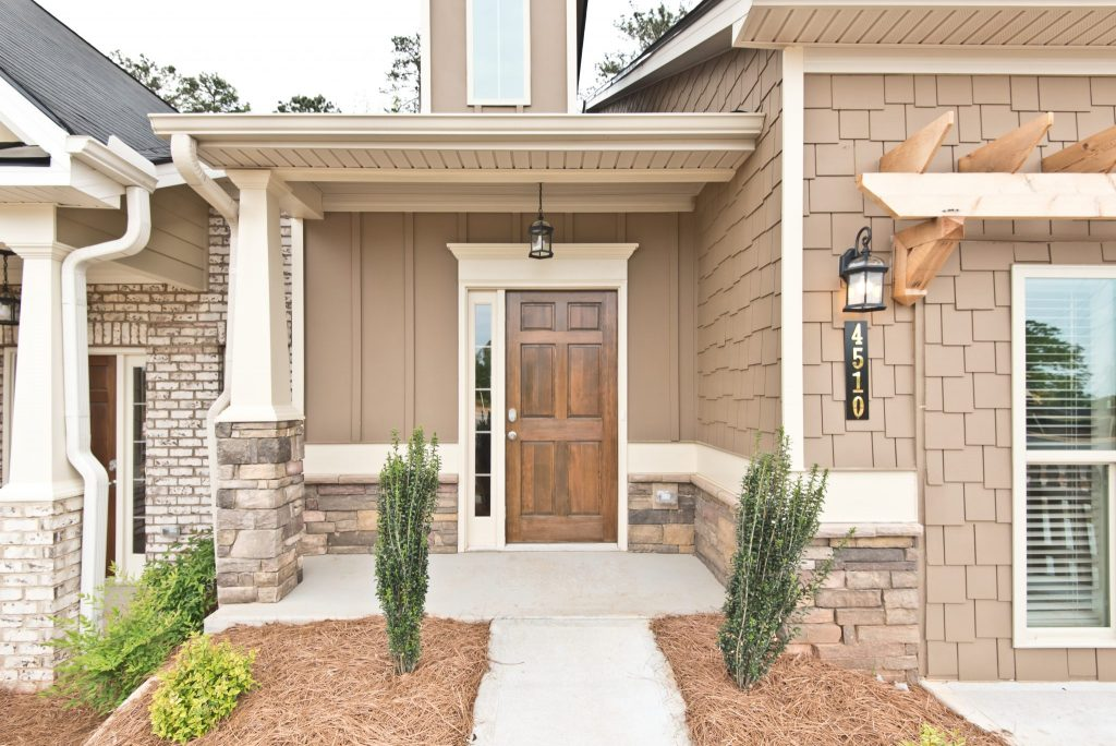A compact porch front entry style in Villas at Hickory Grove