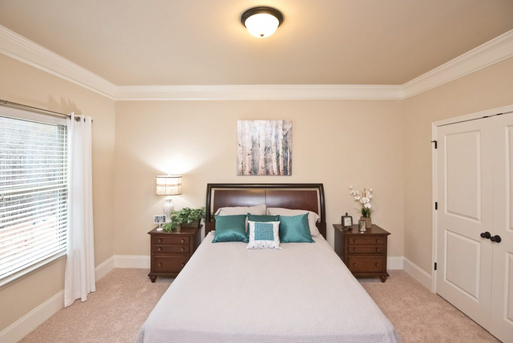 A ground-level guest bedroom in perennial walk