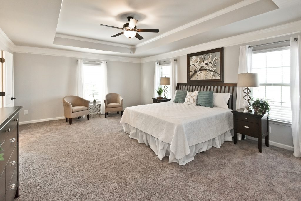 A spacious master with seating area