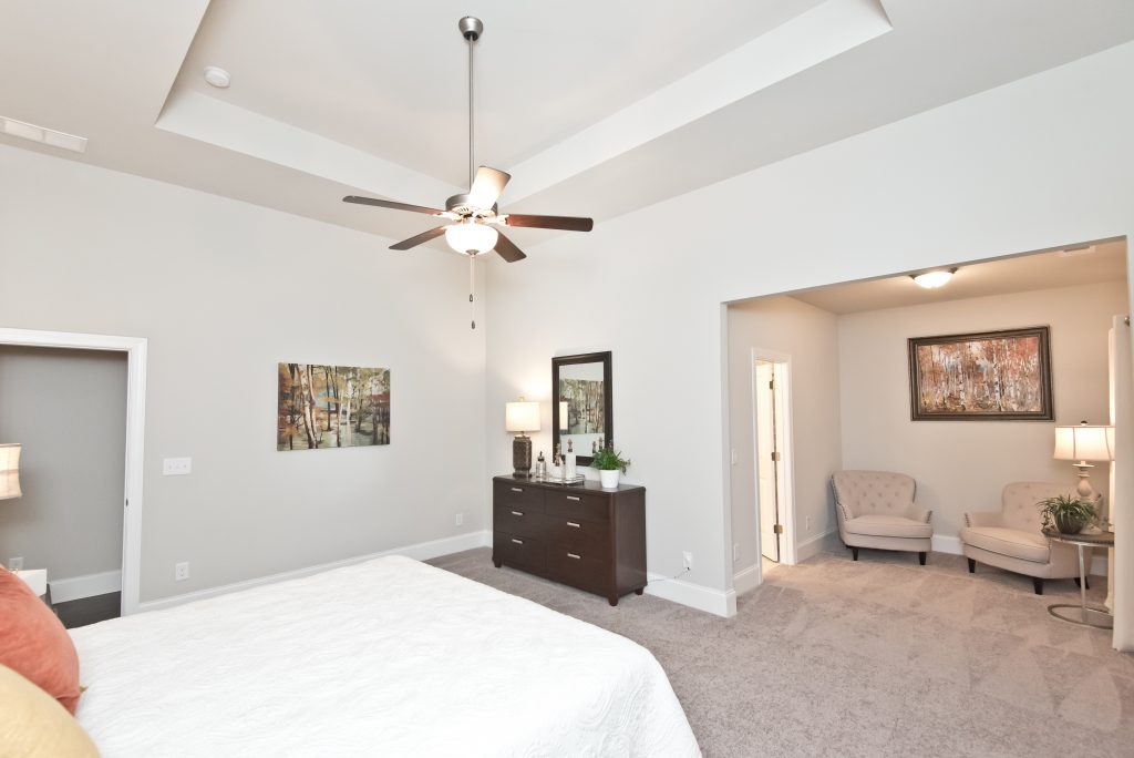 A master suite with sitting area