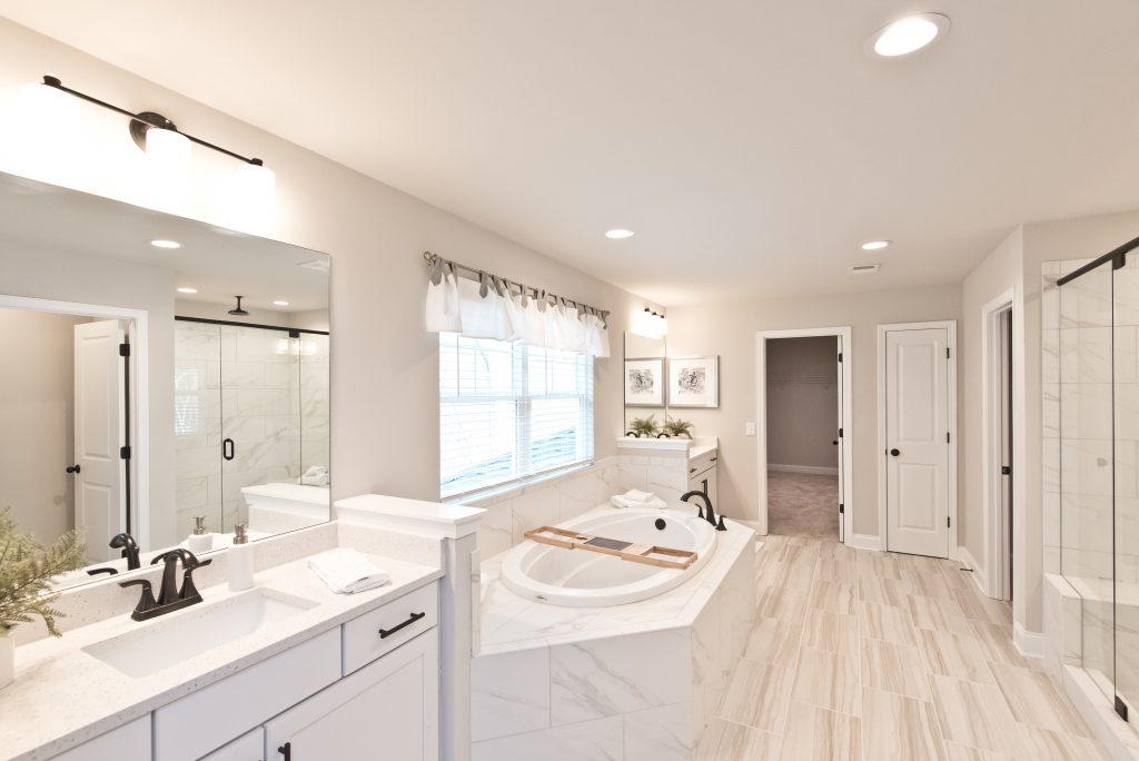 a beautiful master bathroom in Gunnerson Pointe