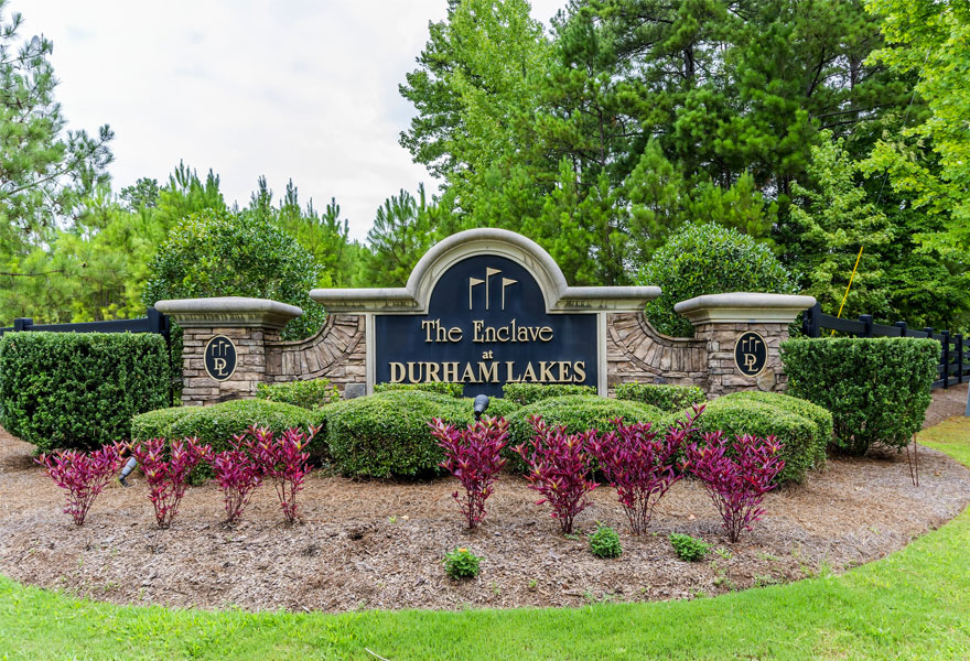 the monument in front of the new homes for sale in fairburn georgia at Enclave at Durham Lakes
