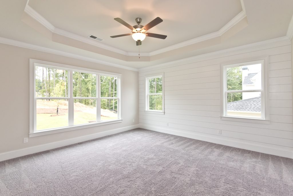 Interior of a Semi-Custom Home in Gunnerson Pointe with Tray Ceilings and a Shiplap Accent Wall