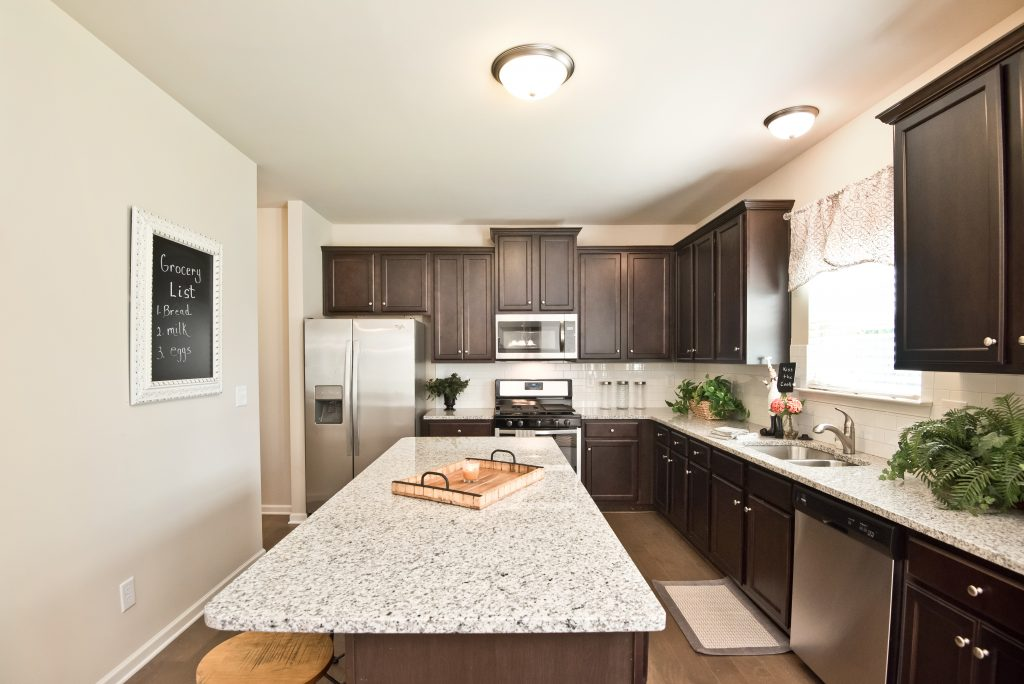Kitchen with Oversized Island in Maple Village