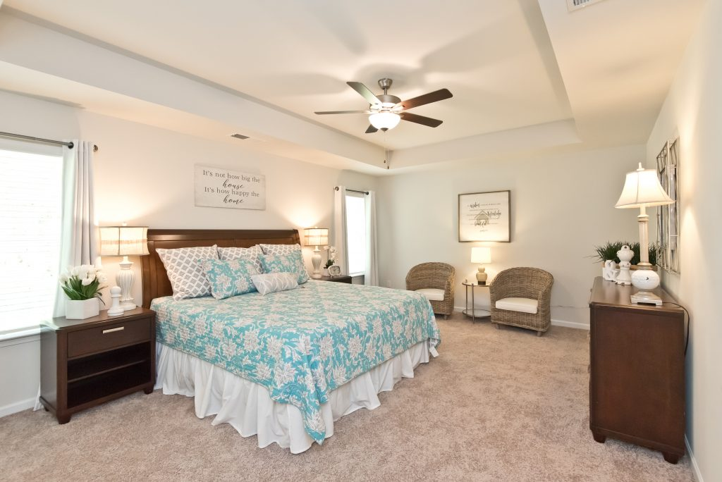 A master bedroom with tray ceilings