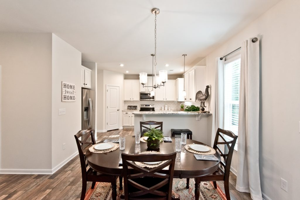 A dining room in a kerley family homes community