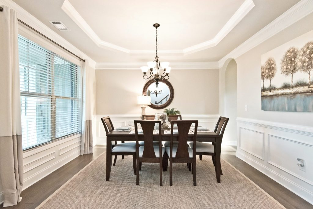 A dining room on the main level of a River Rock home