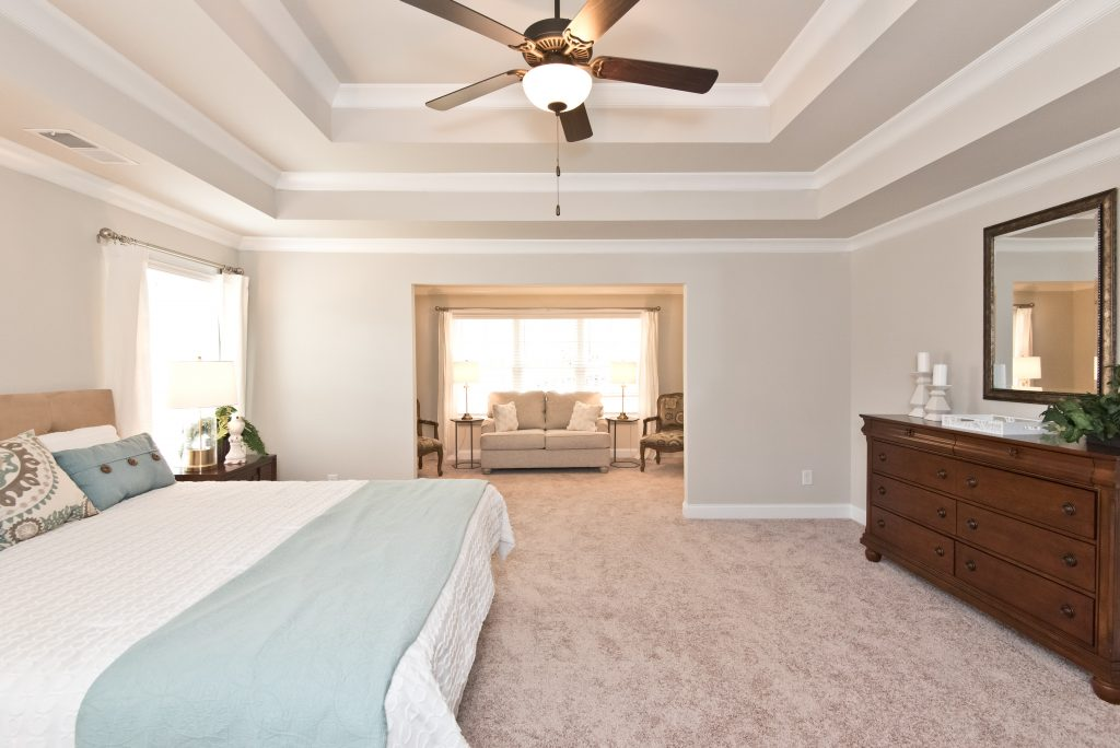 a bedroom with sitting room